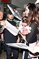 lana del rey receives flowers at lax airport 08