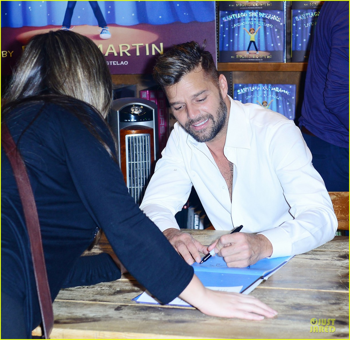 ricky martin flashes chest hair for santiago signing 02