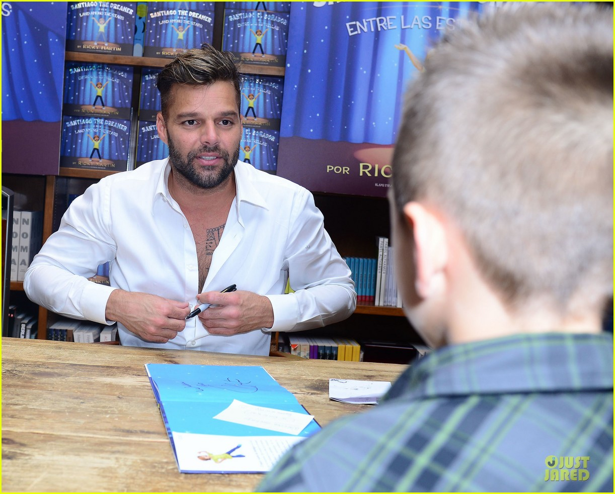 ricky martin flashes chest hair for santiago signing 04