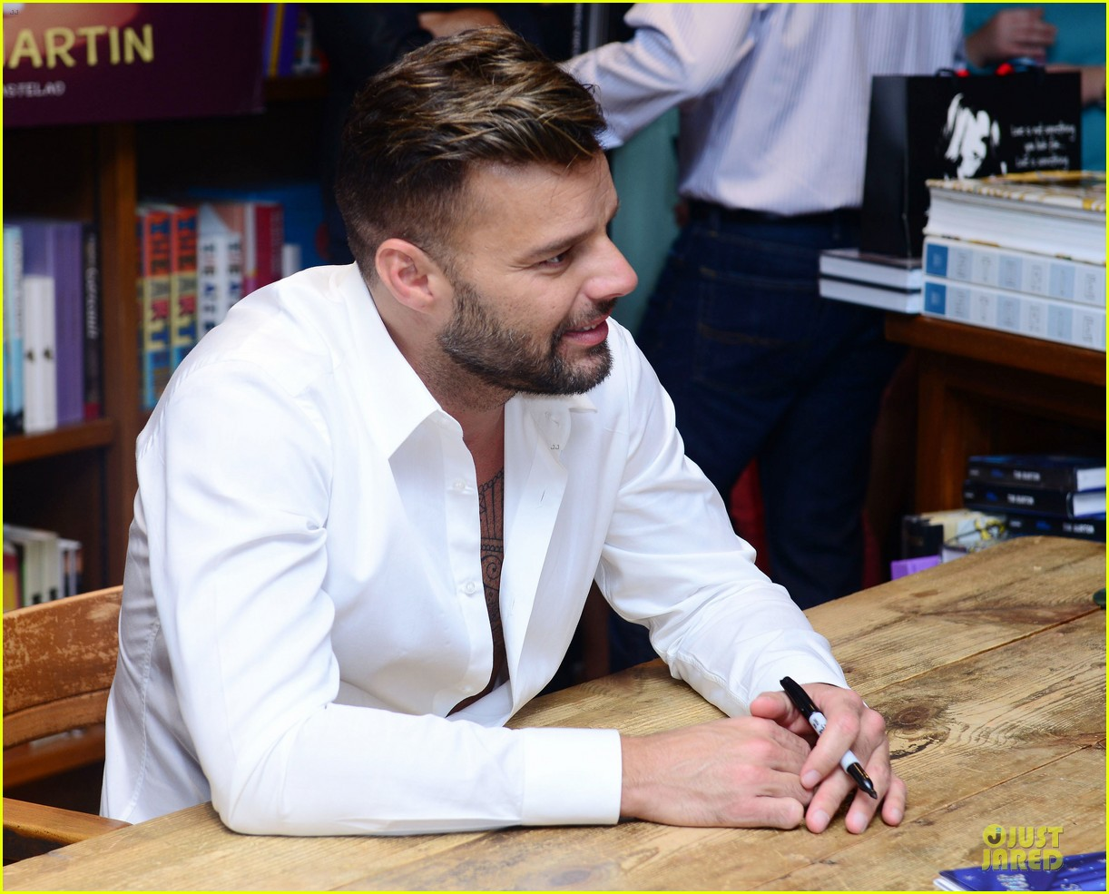 ricky martin flashes chest hair for santiago signing 08
