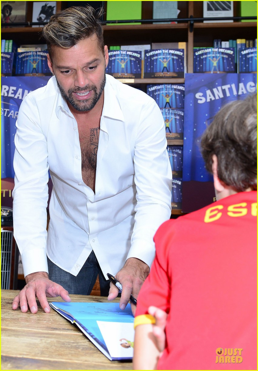 ricky martin flashes chest hair for santiago signing 112994123