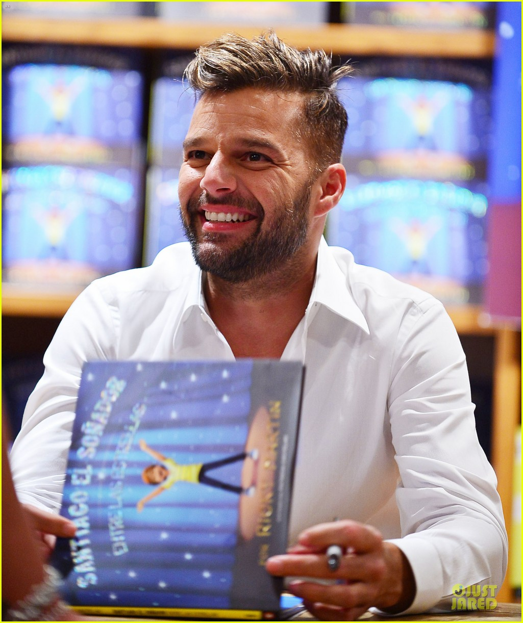 ricky martin flashes chest hair for santiago signing 182994130