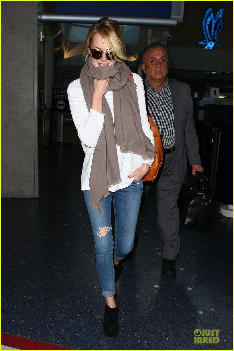emma stone lands in lax airport after quiet few months 05
