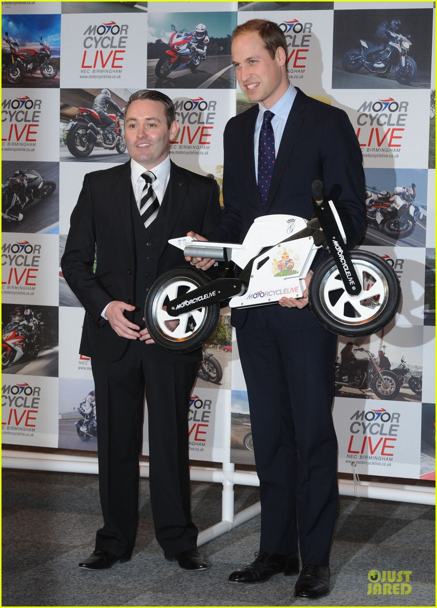 prince william receives gift at motorcycle live show 03