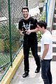 josh bowman promotes john john on brazilian favela visit 01