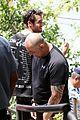 josh bowman promotes john john on brazilian favela visit 13