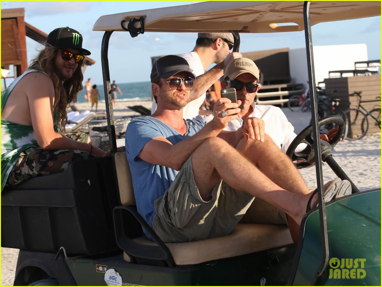 gerard butler kicks back takes photos during golf cart ride 183006674