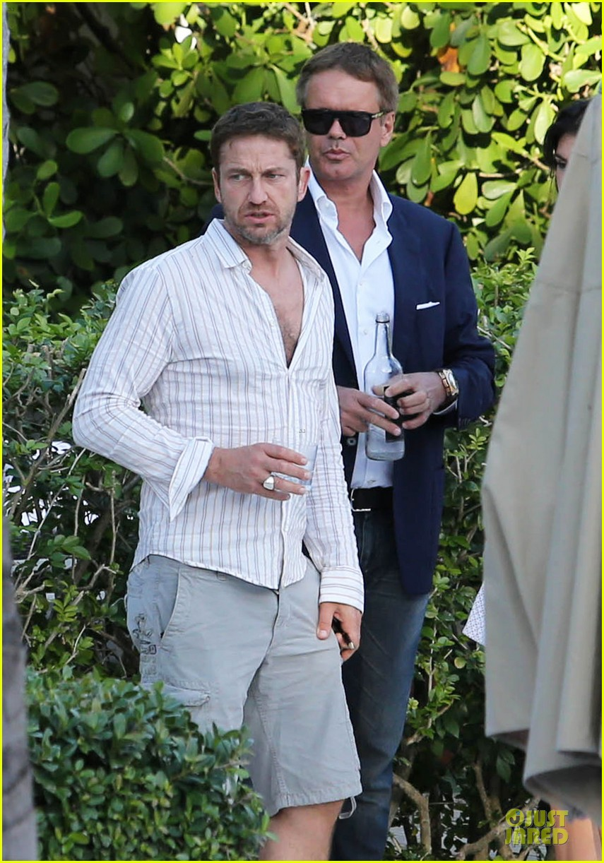 gerard butler relaxes at miami hotel pool with friends 183004341