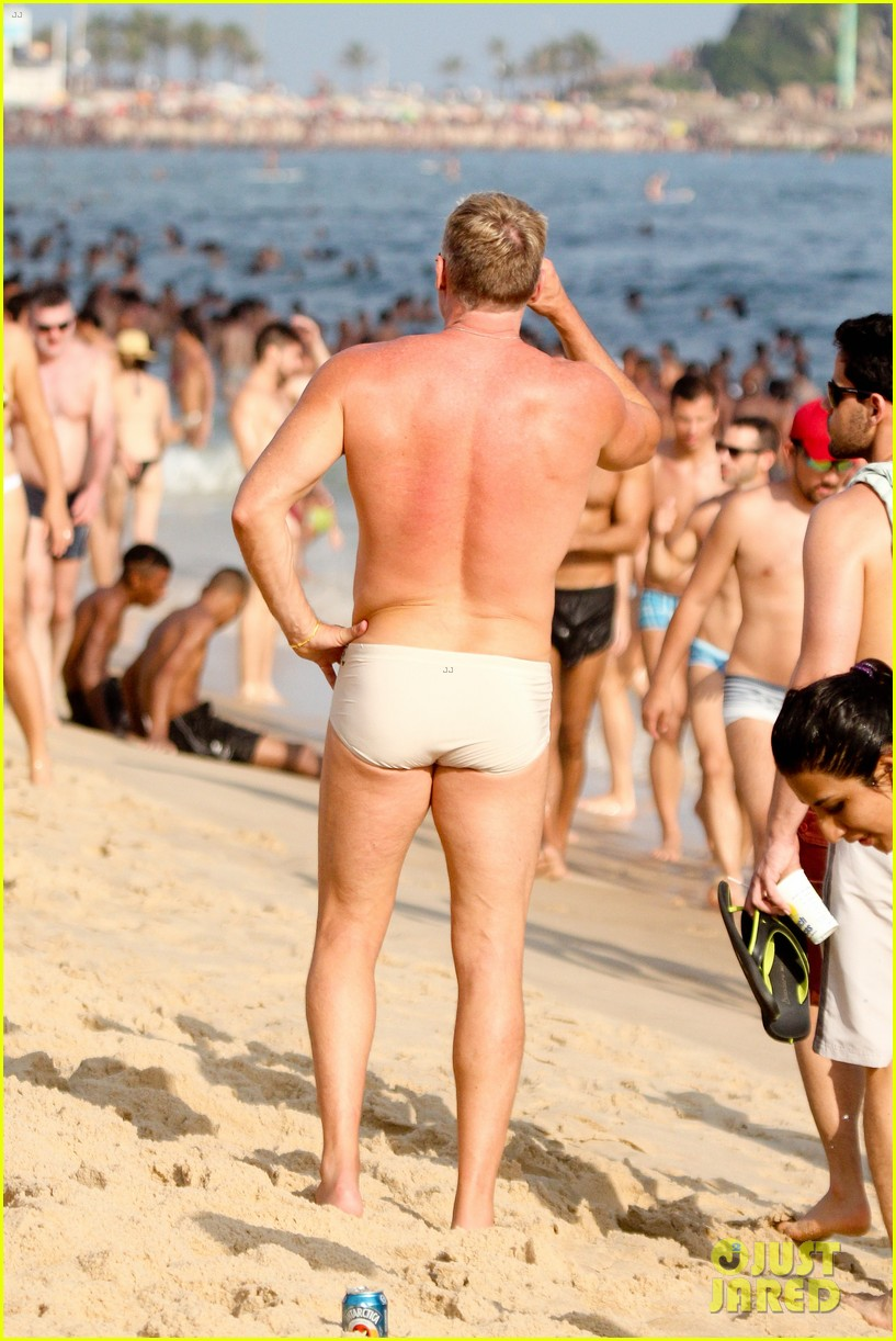 sam champion strips off board shorts to show speedo 03