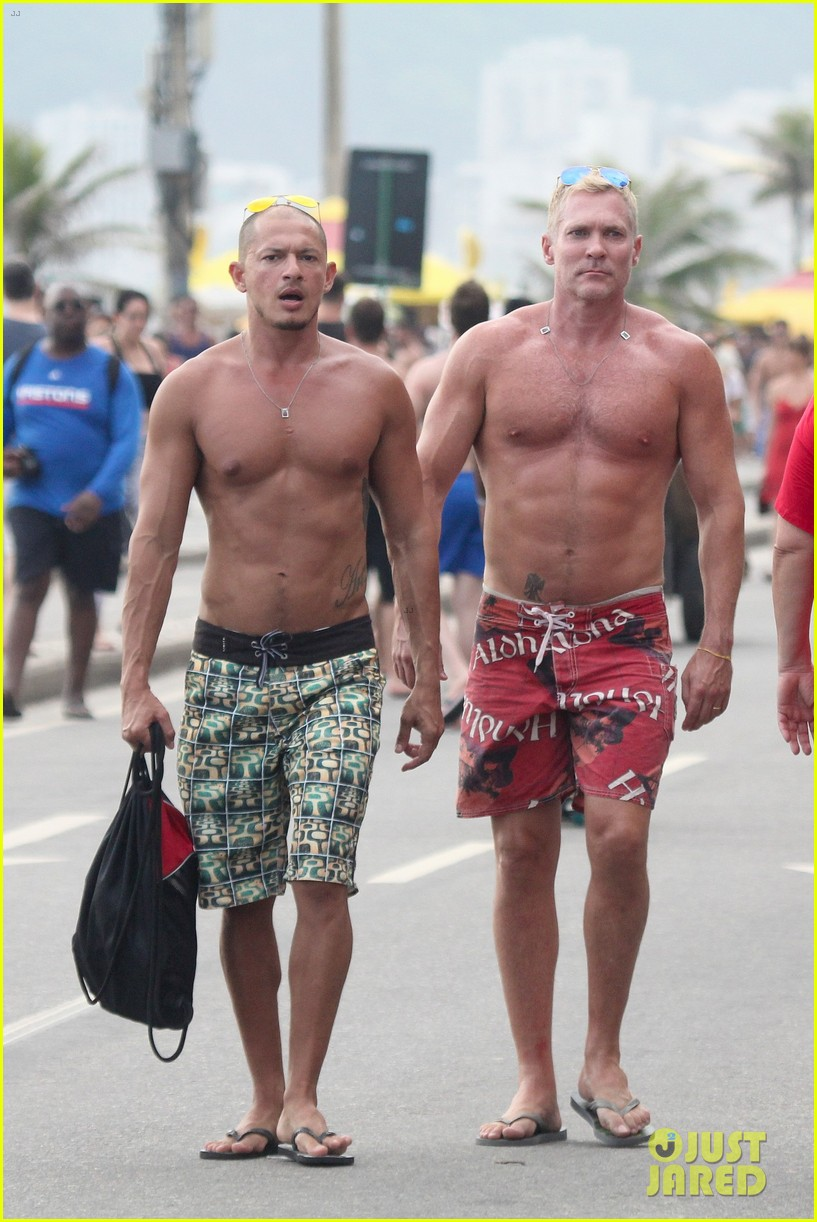sam champion strips off board shorts to show speedo 05