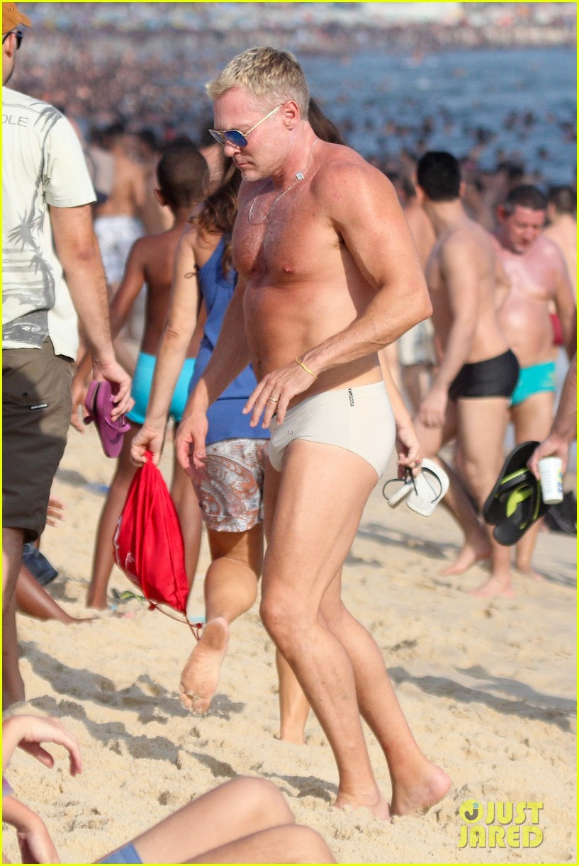 sam champion strips off board shorts to show speedo 083020027