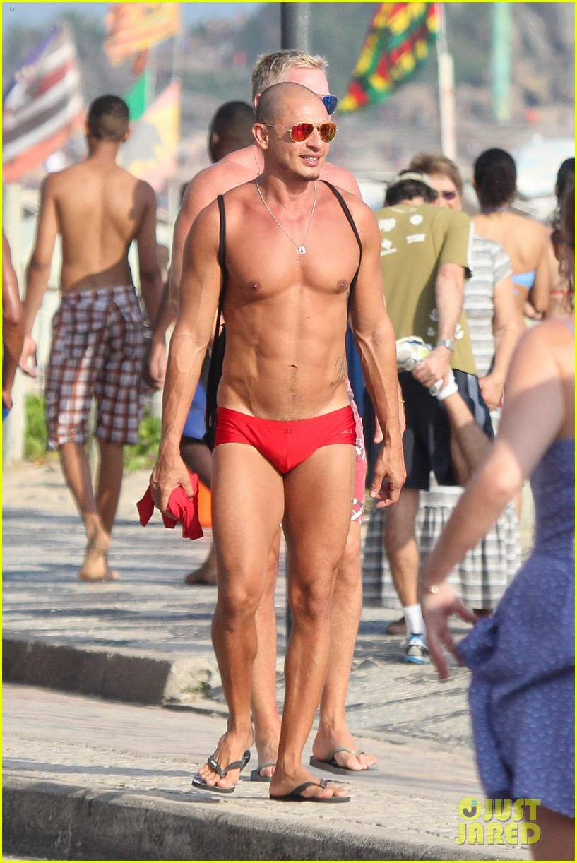 sam champion strips off board shorts to show speedo 173020036