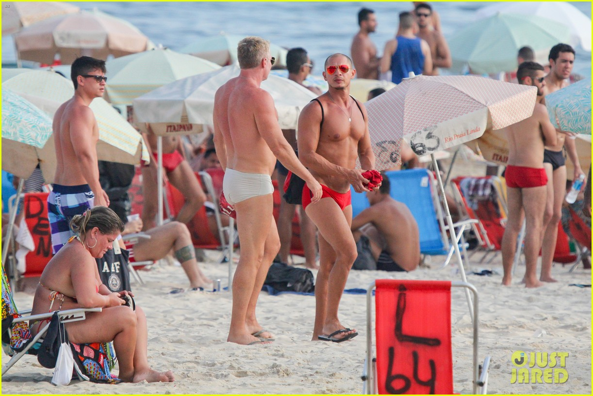 sam champion strips off board shorts to show speedo 20