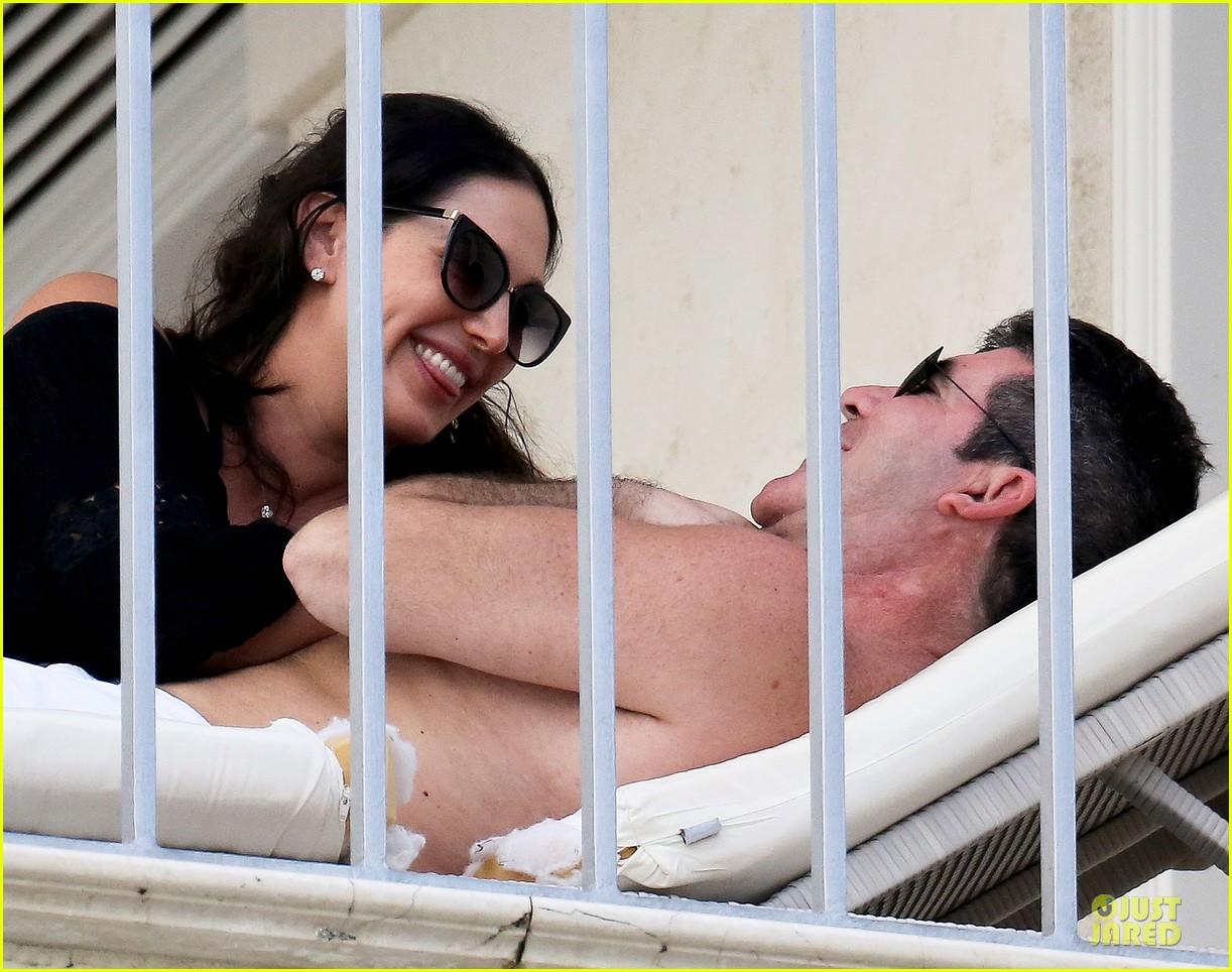 simon cowell lauren silverman kissing cuddling pair 063020073