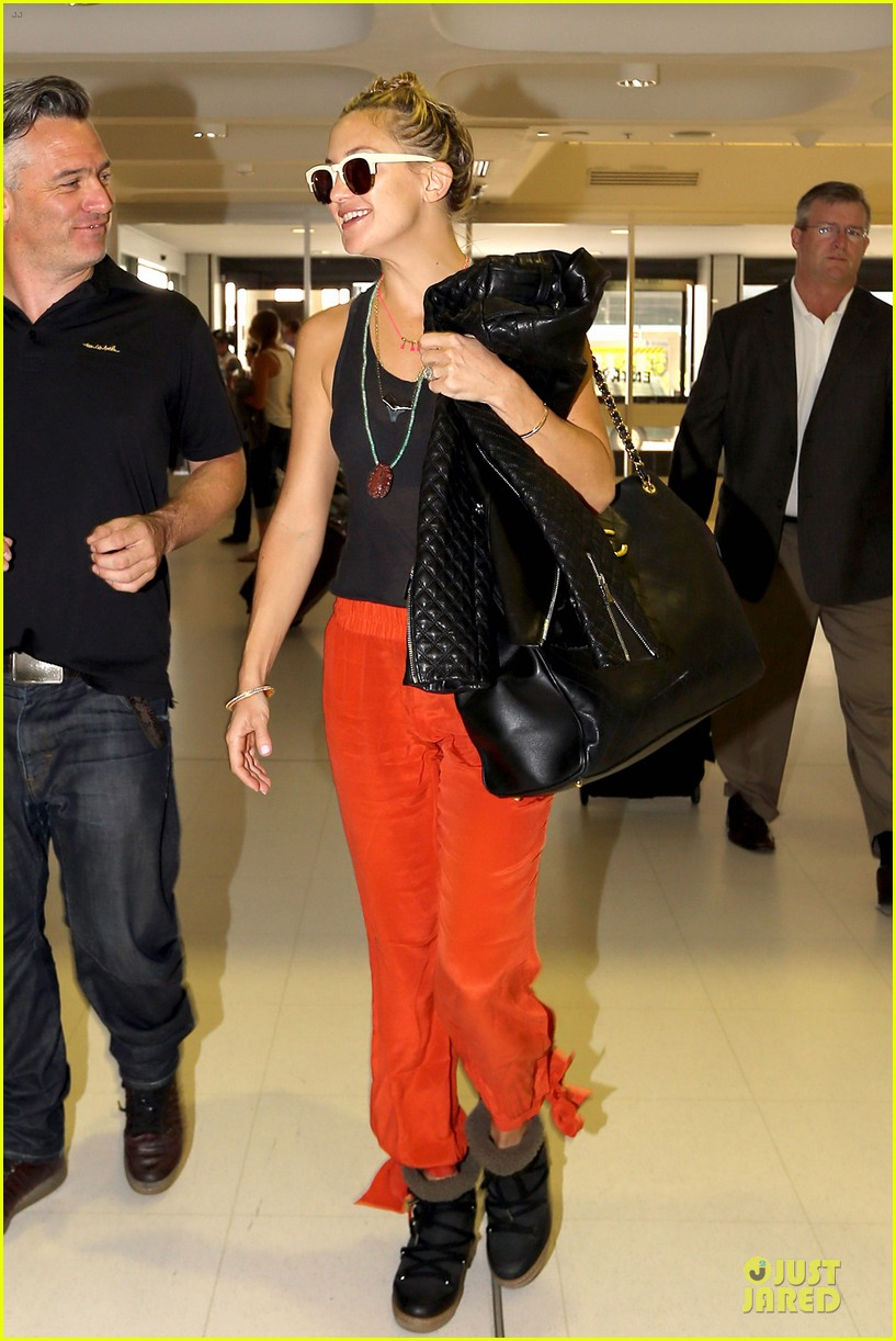 kate hudson bright orange sydney departure 073011865