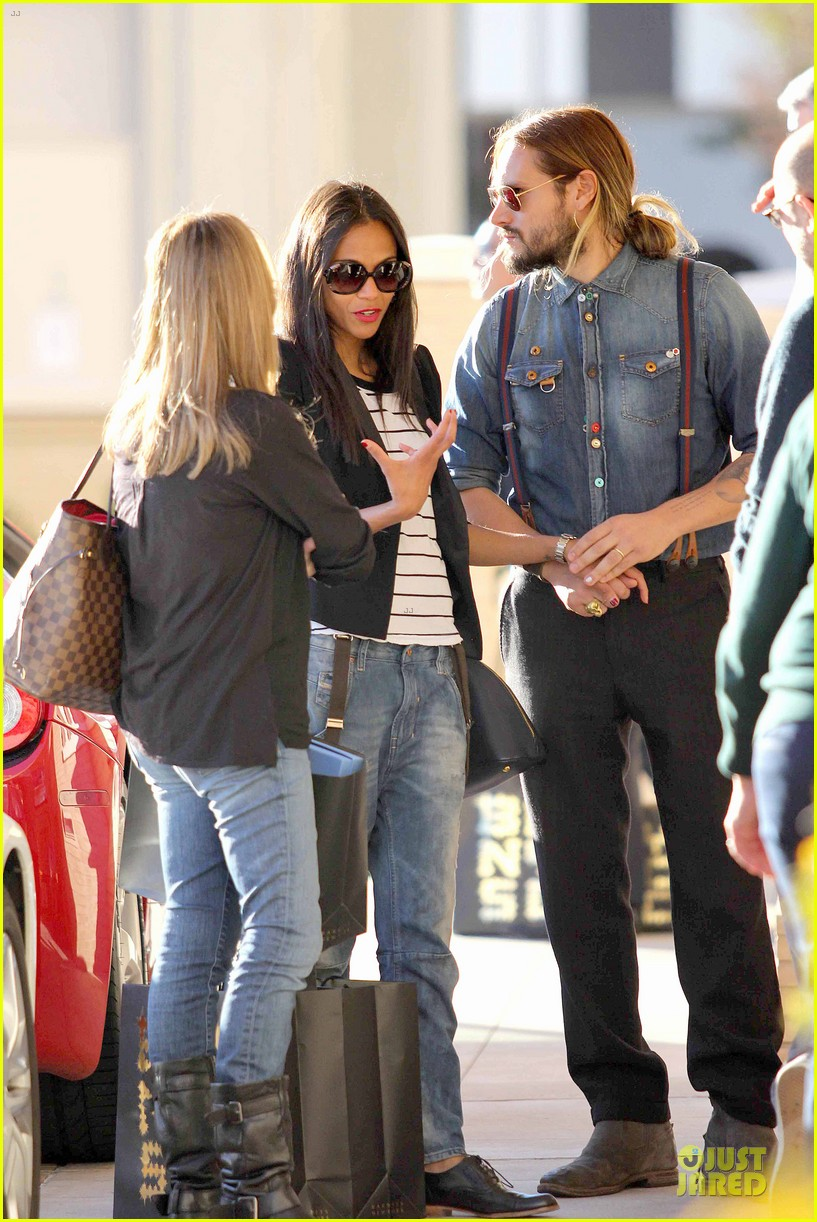 zoe saldana adoring kiss from marco perego at barneys 01