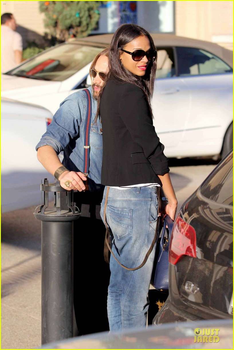 zoe saldana adoring kiss from marco perego at barneys 123016880