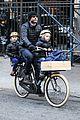 naomi watts takes subway while her boys bike to school 01