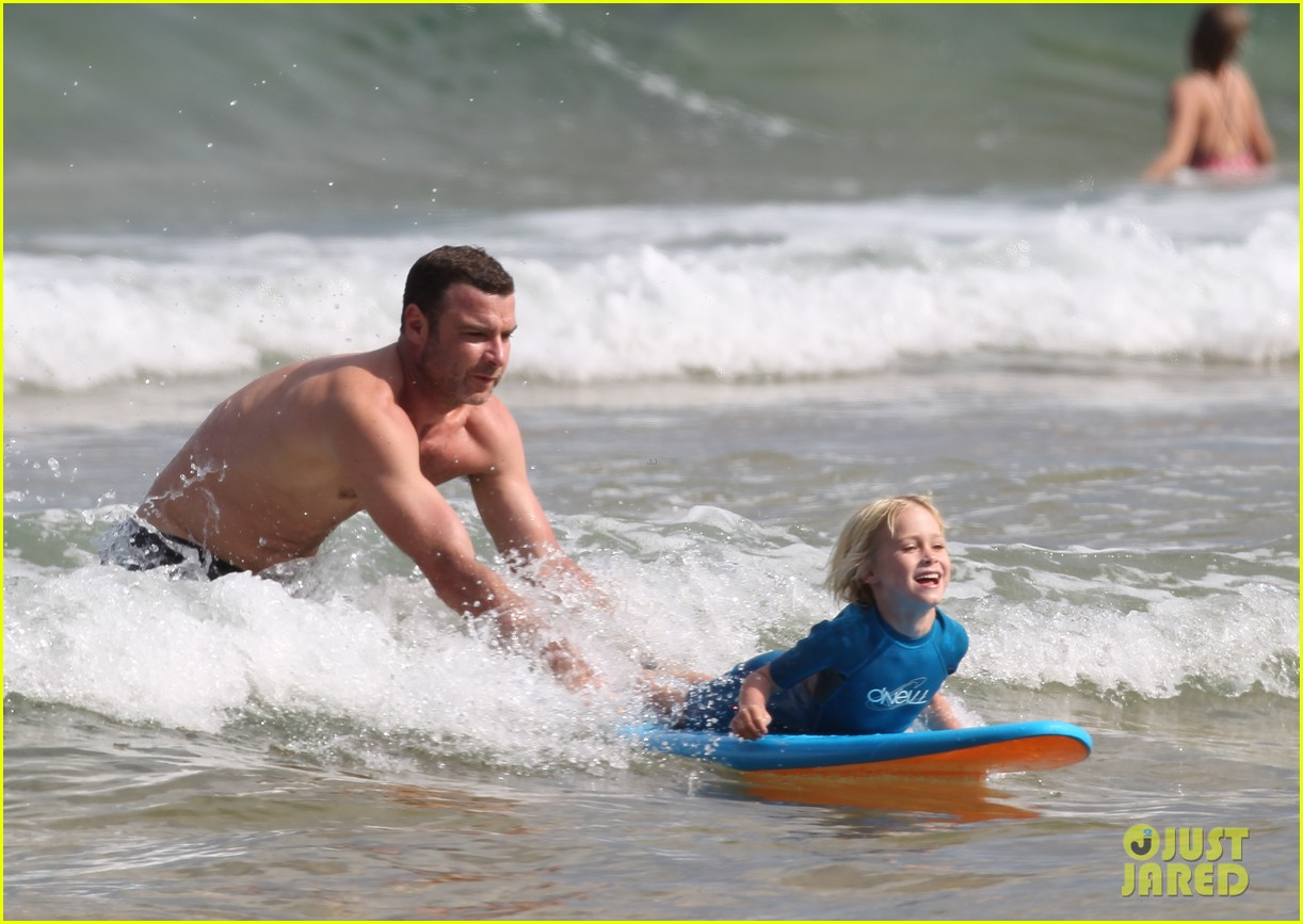 naomi watts sunbathes liev schreiber swims shirtless 103015399