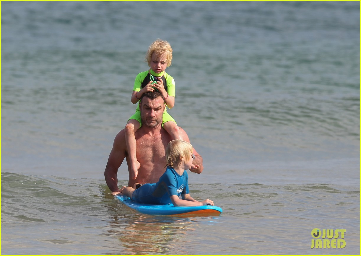 naomi watts sunbathes liev schreiber swims shirtless 163015405