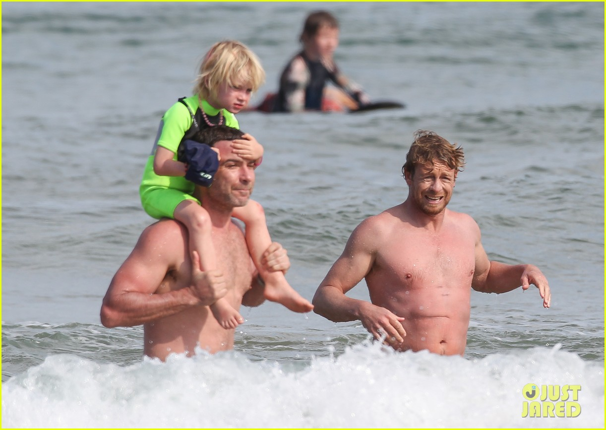 naomi watts sunbathes liev schreiber swims shirtless 32