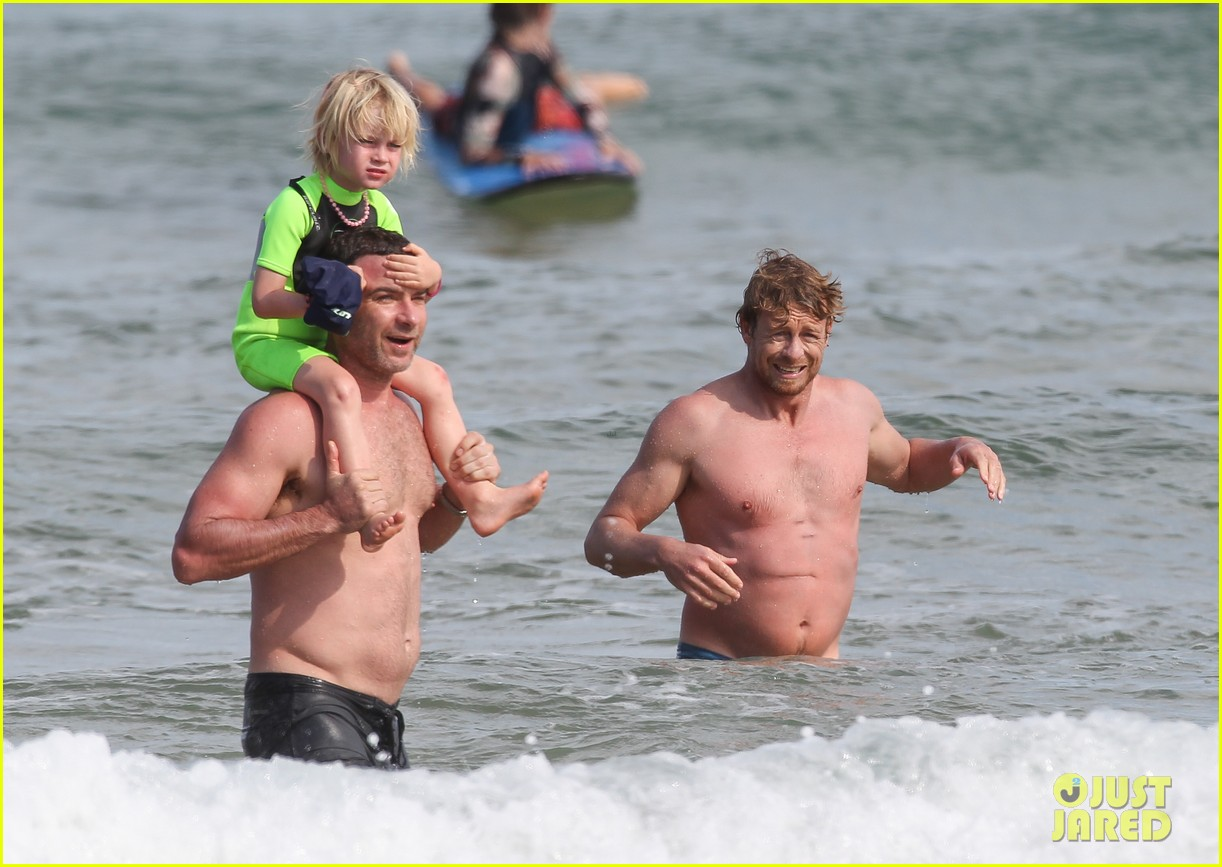 naomi watts sunbathes liev schreiber swims shirtless 333015422