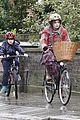 helena bonham carter bikes in the rain with son billy 03