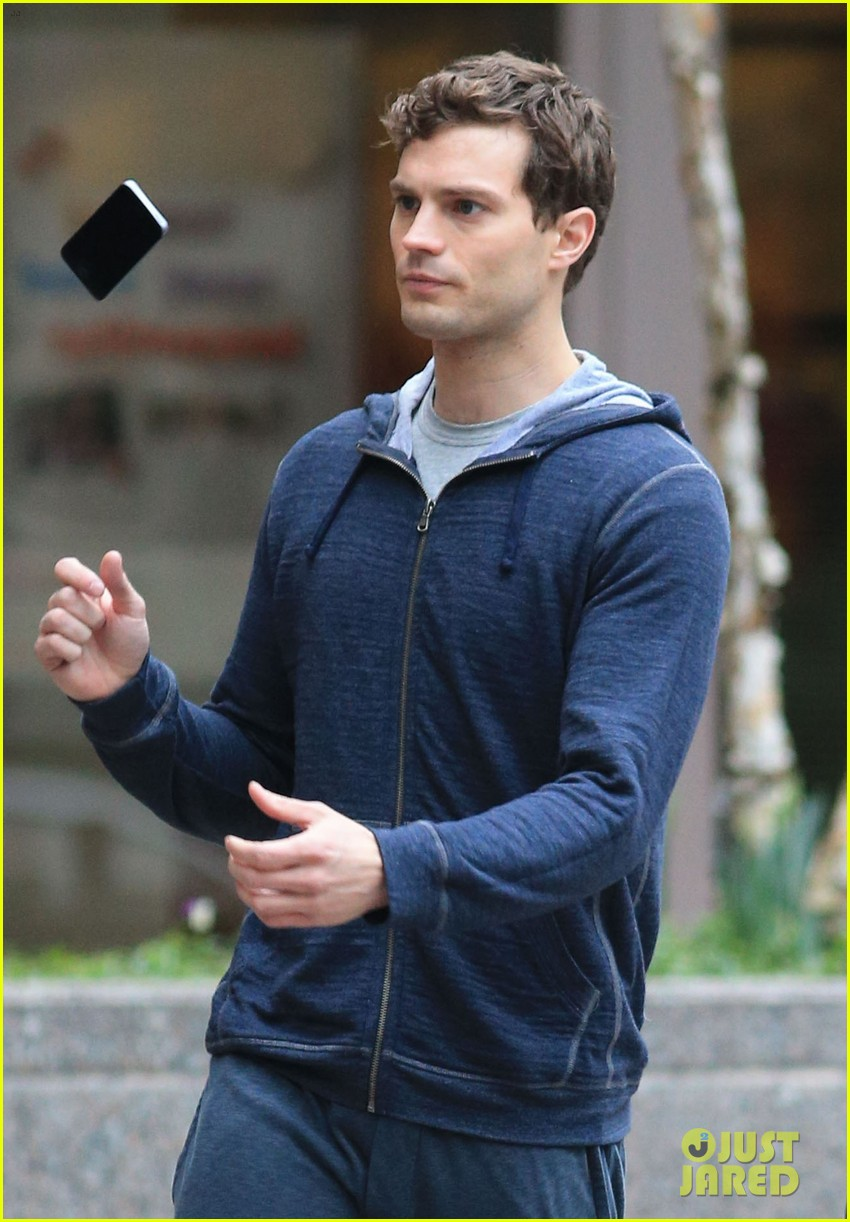 jamie dornan runs in the rain for fifty shades of grey 07