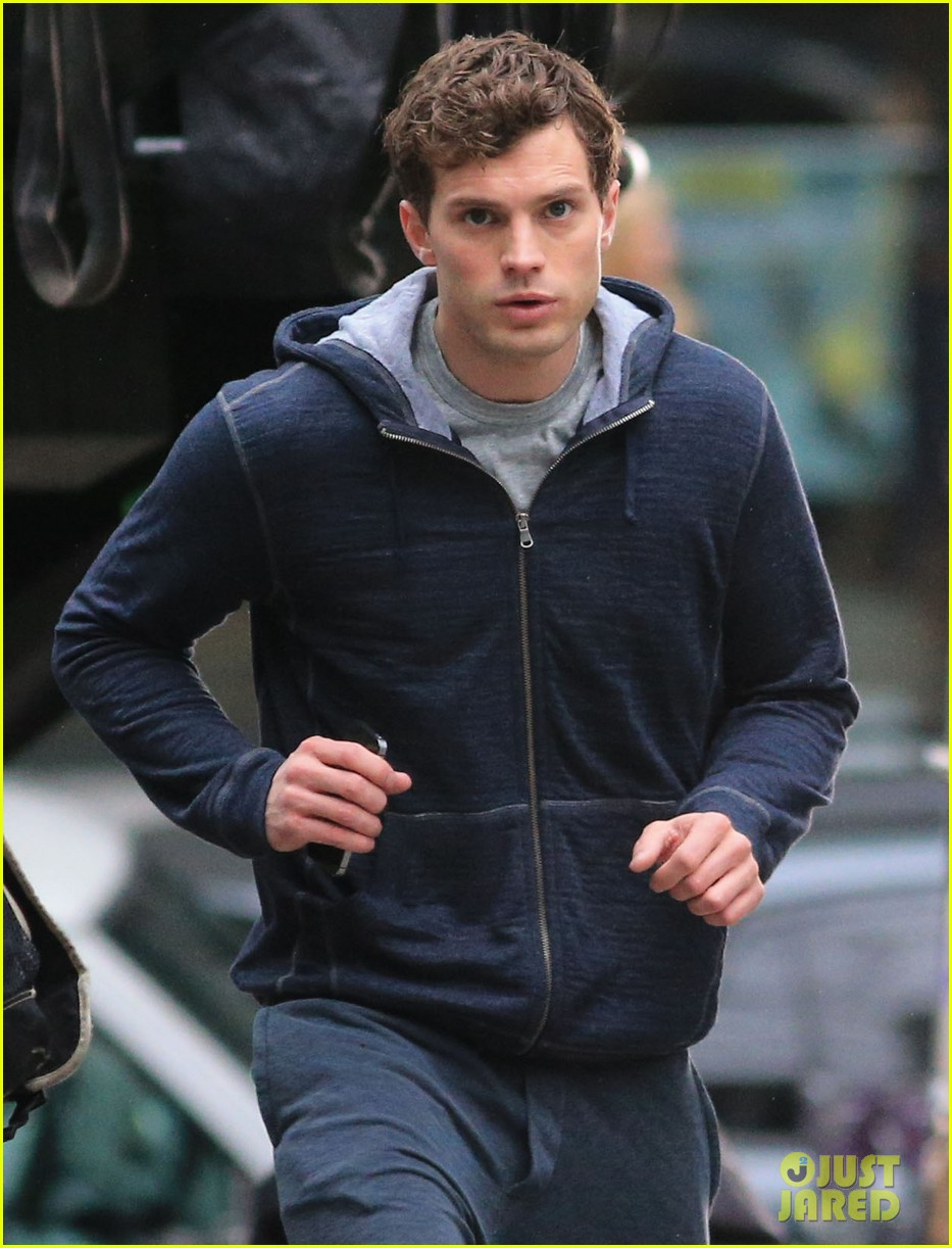 jamie dornan runs in the rain for fifty shades of grey 103043907