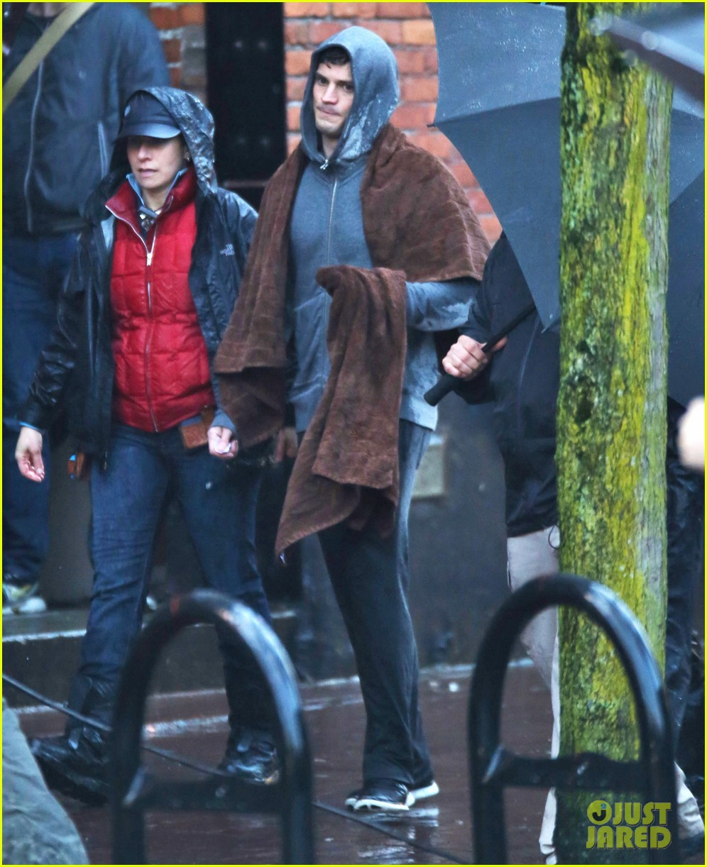 jamie dornan runs in the rain for fifty shades of grey 31