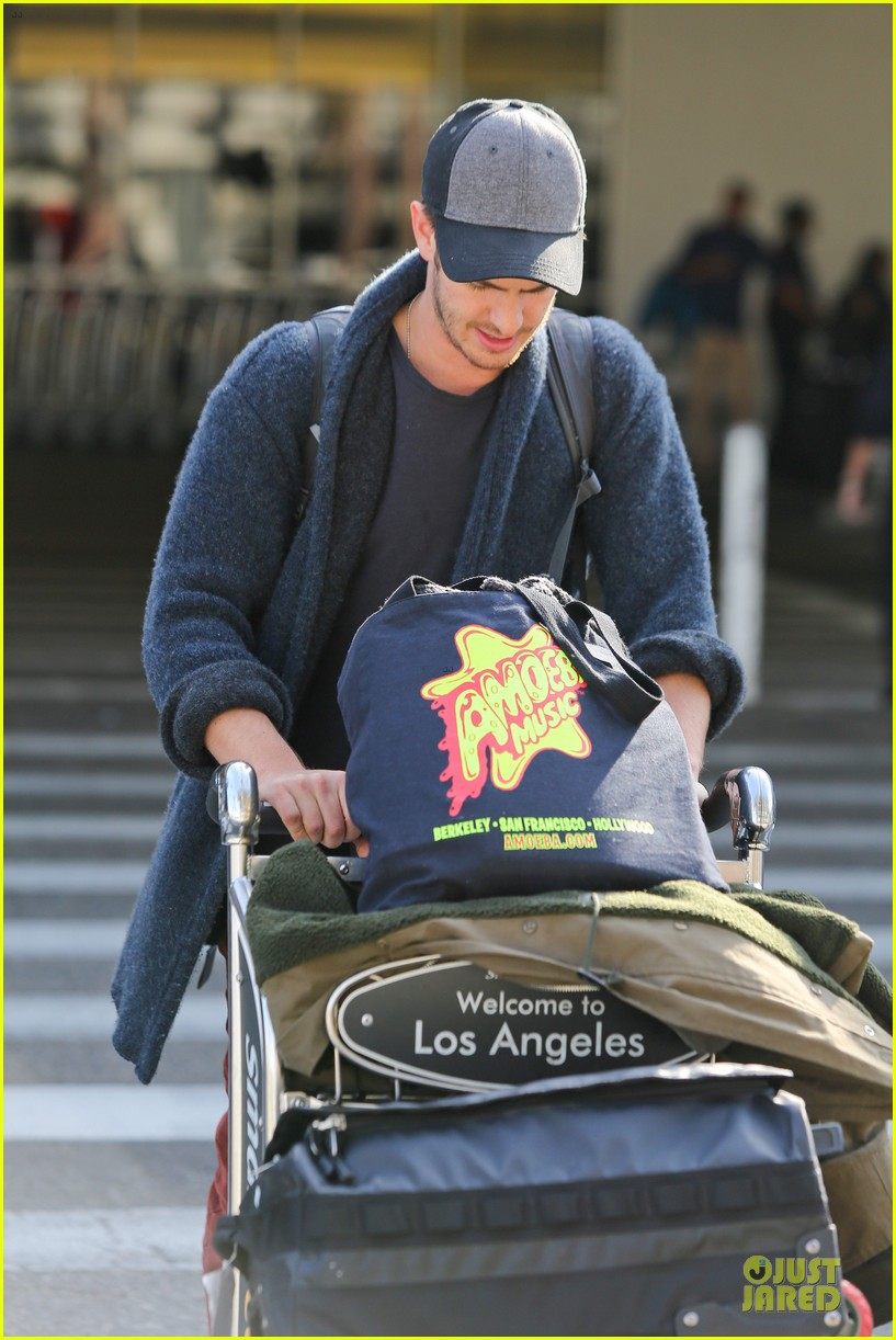 andrew garfield poses with spiderman fan at lax airport 093042313