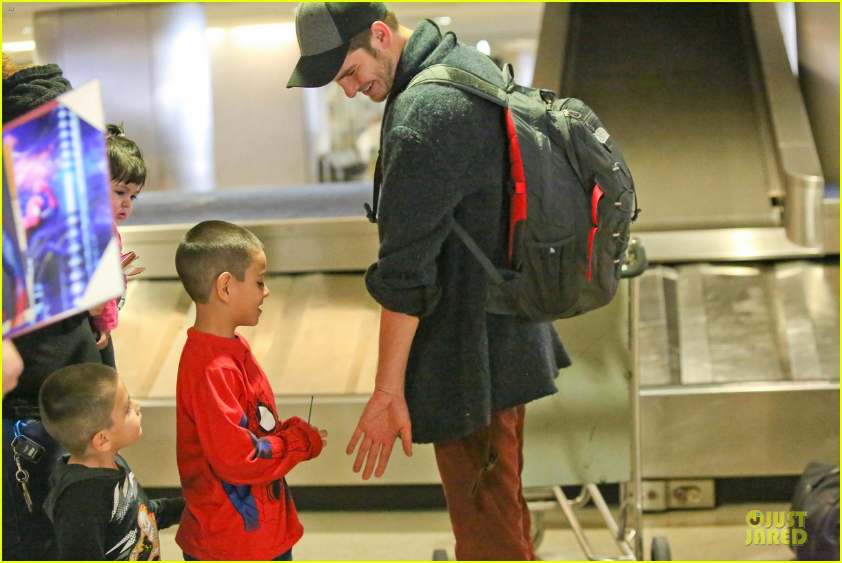 andrew garfield poses with spiderman fan at lax airport 163042320