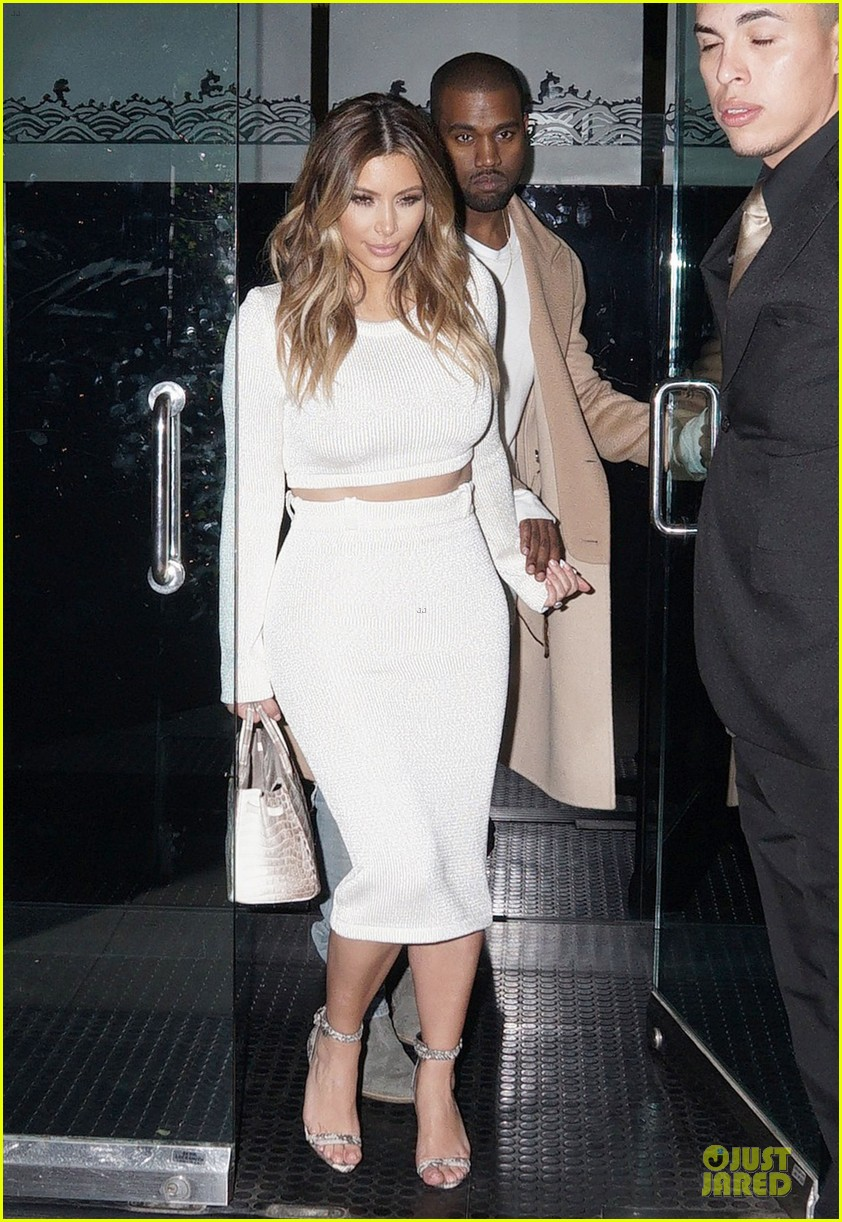 kim kardashian bares midriff for dinner with kanye west 09