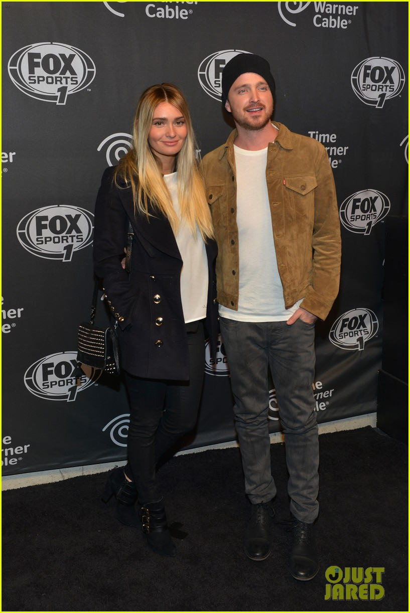 aaron paul kicks his heels up his wife seems unimpressed 06