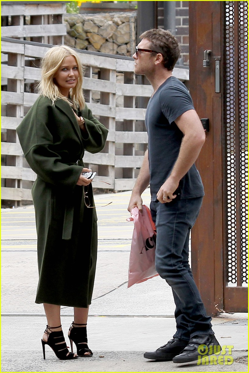 sam worthington lara bingle wear matching rings on that finger 133038659