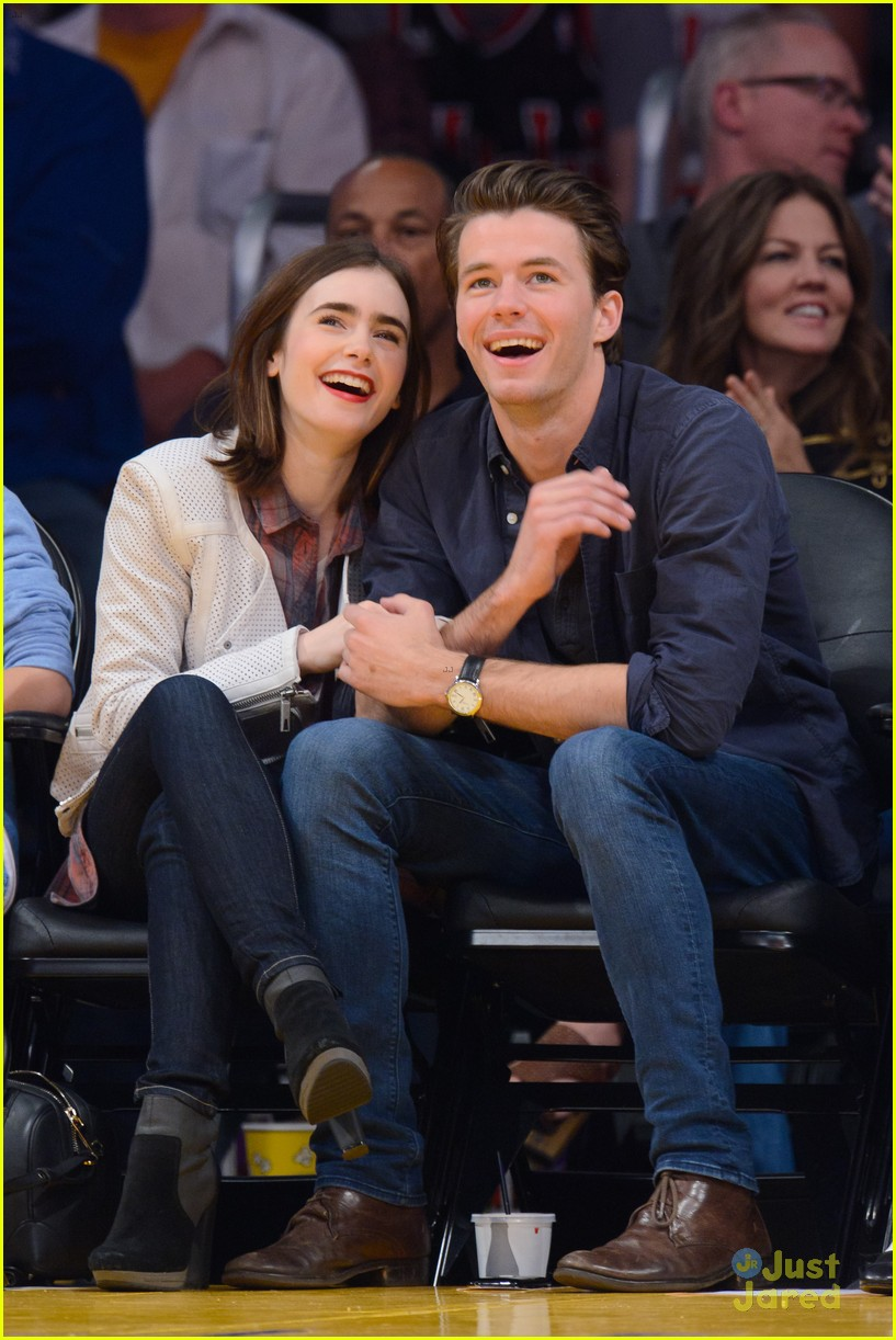 lily collins boyfriend thomas cocquerel hold hands at lakers game 02