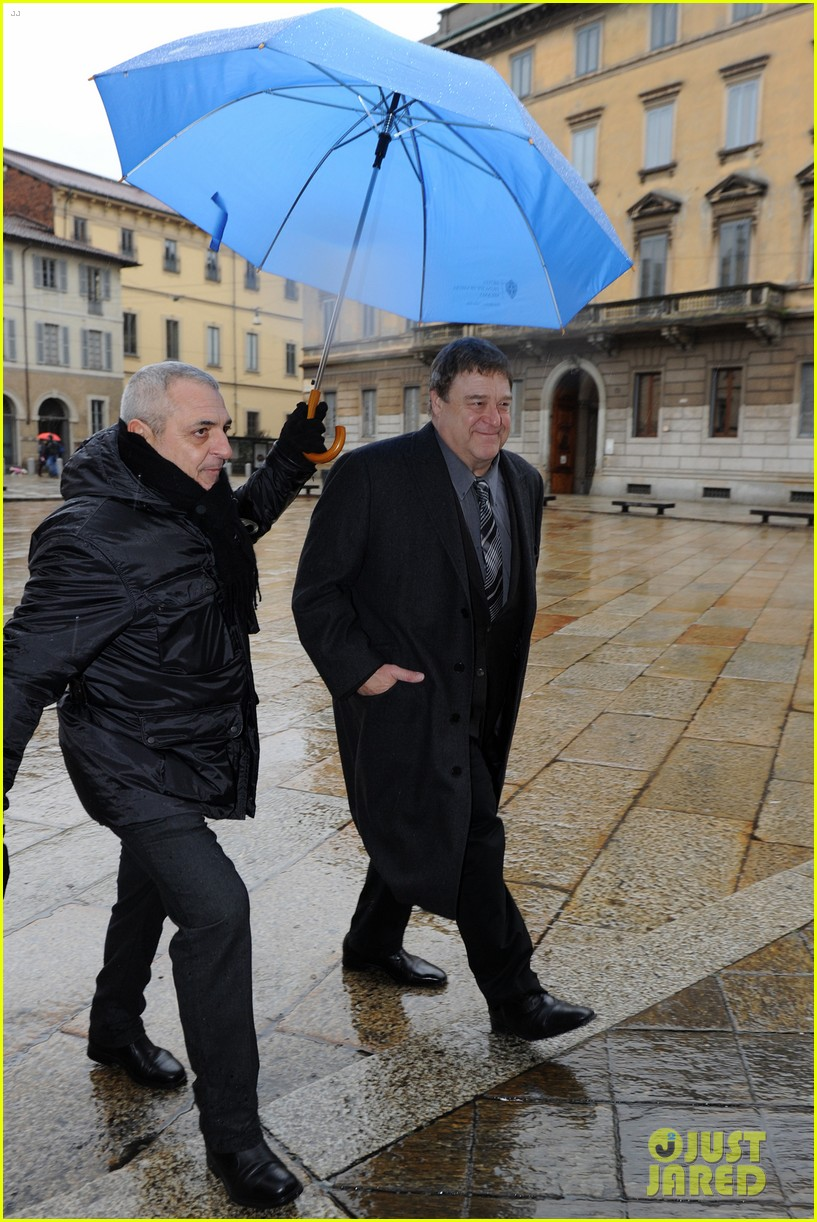 matt damon george clooney get personal umbrella holders in milan 15