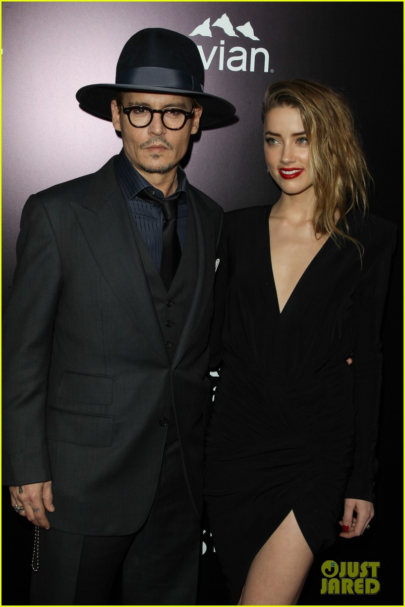 johnny depp supports amber heard at 3 days to kill premiere 123052503