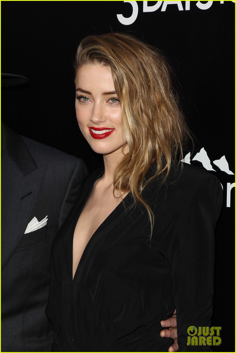 johnny depp supports amber heard at 3 days to kill premiere 13