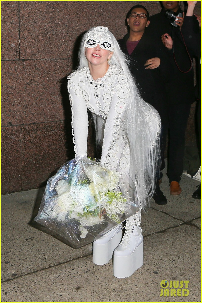 lady gaga is a bride see her throwing a bouquet of flowers 24