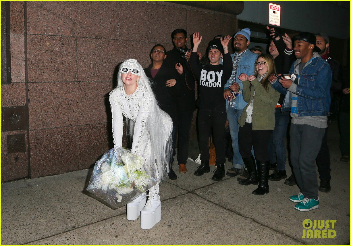 lady gaga is a bride see her throwing a bouquet of flowers 29