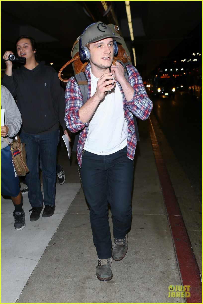 josh hutcherson shows macho strength at lax arrival 09