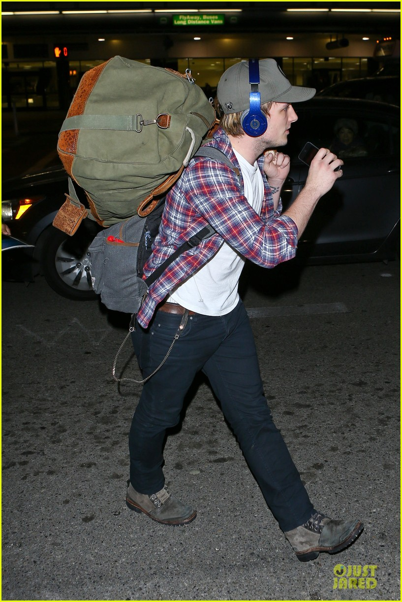 josh hutcherson shows macho strength at lax arrival 14