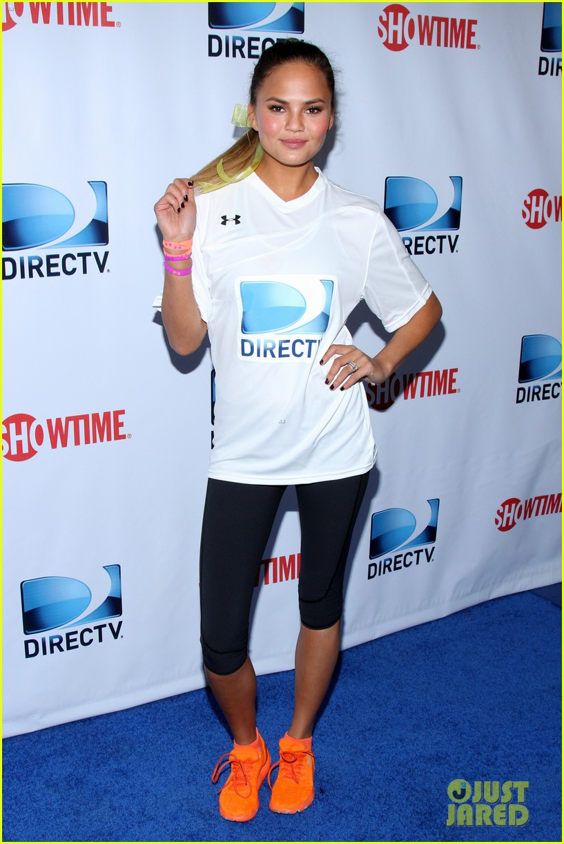 john legend chrissy teigen competing couple directv beach bowl 2014 023045654
