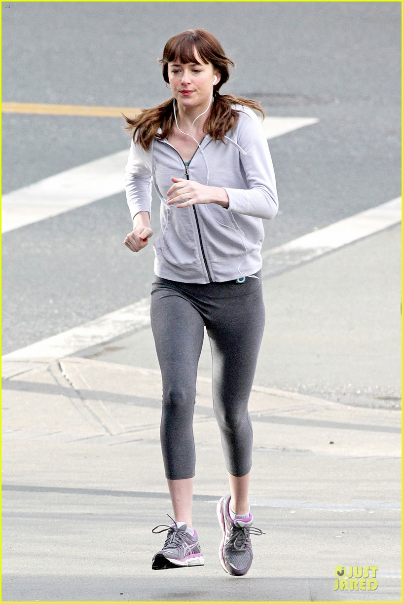 dakota johnson runs for fifty shades in pigtails 013053488