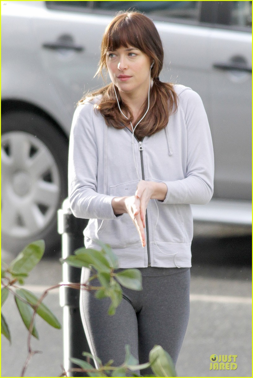 dakota johnson runs for fifty shades in pigtails 093053496