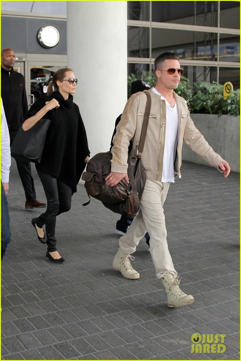 Full Sized Photo of angelina jolie brad pitt land in los ... Angelina Jolie Brad Pitt