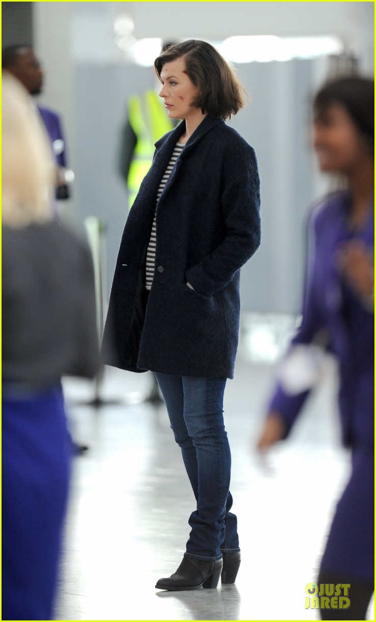 milla jovovich survivor cuts at heathrow airport 13