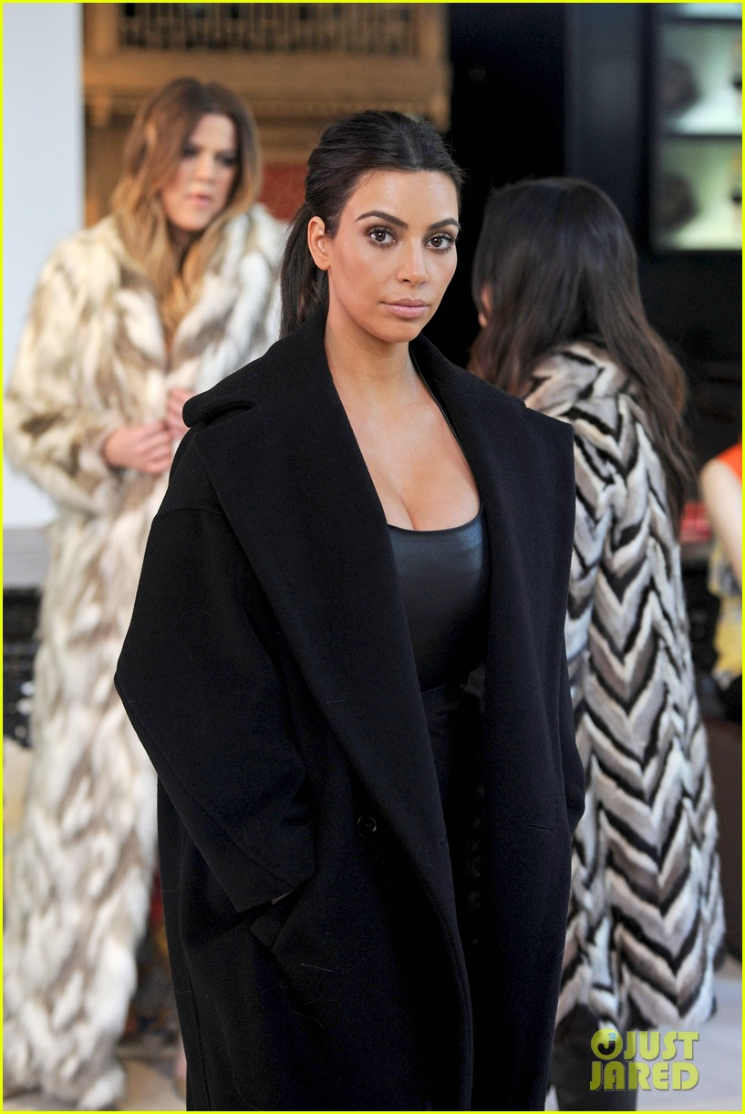 kim kardashian films kuwtk with her sisters khloe sends message on coat fxck yo fur 13