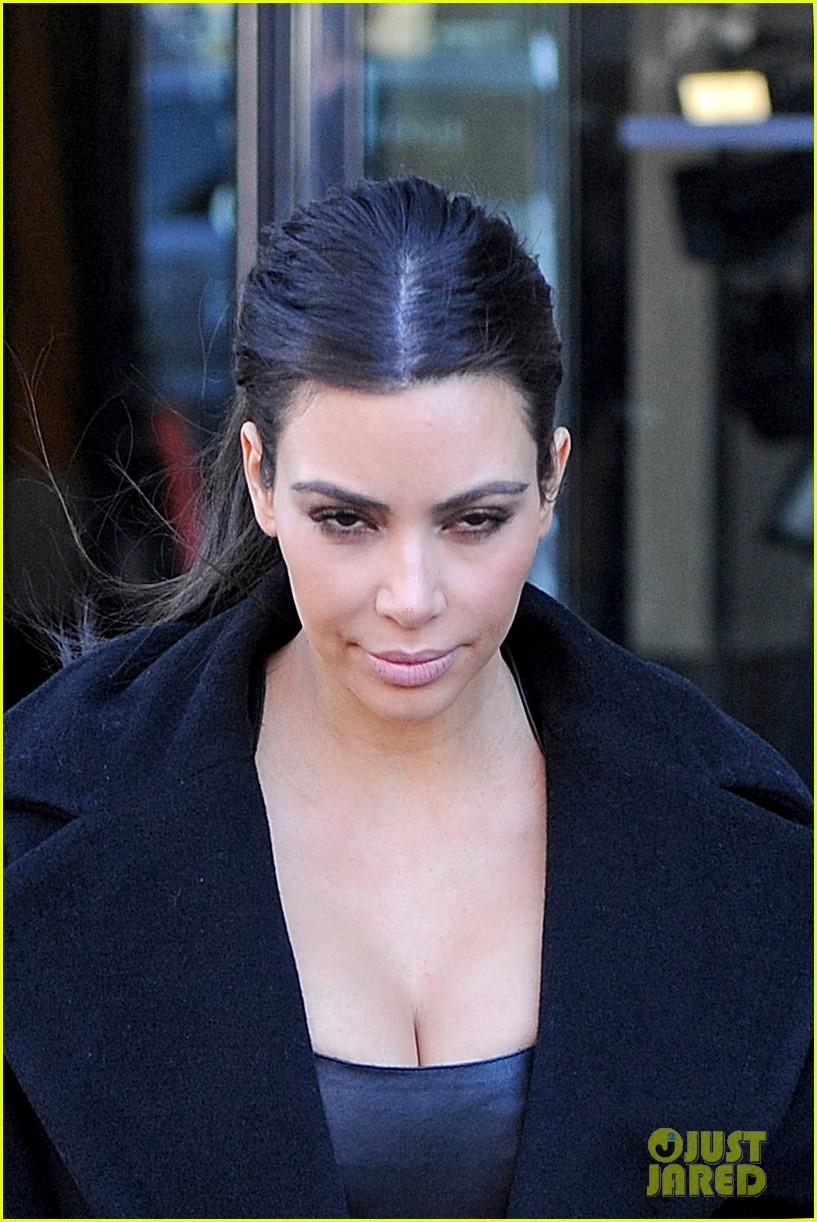 kim kardashian films kuwtk with her sisters khloe sends message on coat fxck yo fur 18